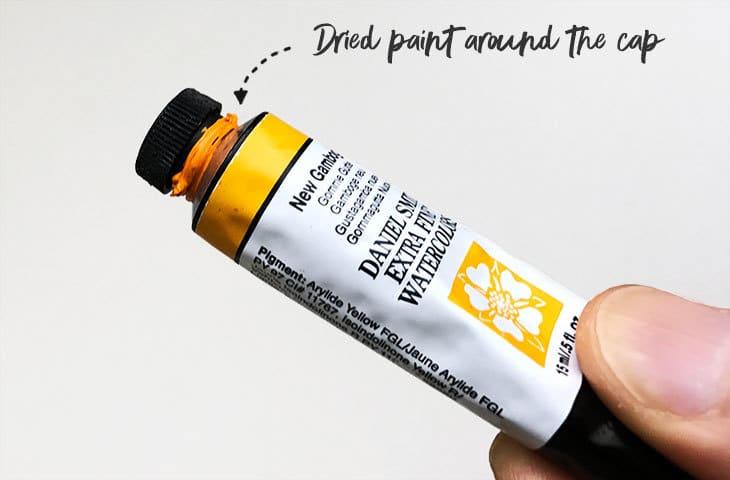 dried watercolor tube cap
